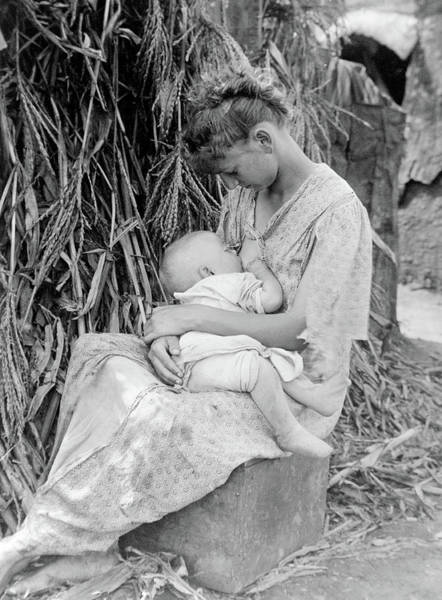 Wall Art - Photograph - Mother Breastfeeding, 1916 by Science Source