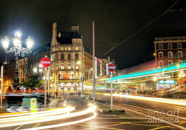 Wall Art - Photograph - Motion On The O'connell Bridge At Night In Dublin by John Rizzuto