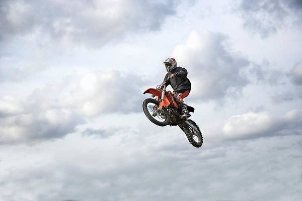 Motocross Photograph - Motocross Rider In Mid-air, Low Angle by Claus Christensen