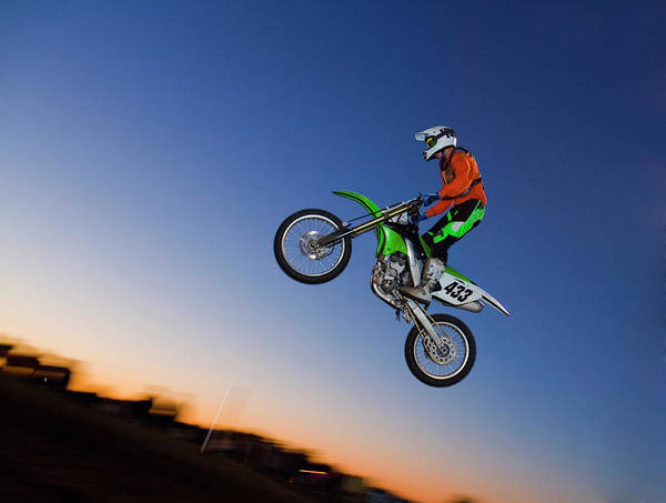 Motocross Photograph - Motorcross Rider Jumping Dirt Bike by Jupiterimages