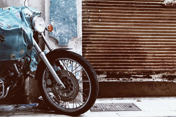 Stationary Photograph - Motorcycle Parked Rusty Garage Door by G.g.bruno