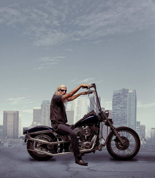 Gray Hair Photograph - Motorcycle Rider With City Background by Ed Freeman