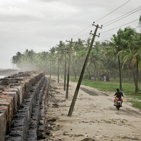 Wall Art - Photograph - Motorcyclist On The Coast Of Kochi by Spencer Wilton