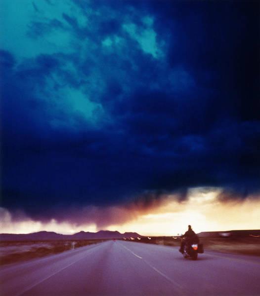 Wall Art - Photograph - Motorcyclist Riding Through Desert by Alan Powdrill