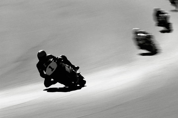 Motorcycle Racing Photograph - Motorcyclists Making Turn On Raceway by David Madison