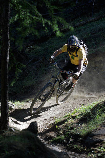 Protection Photograph - Mountain Biker On Dirt Path by Michael Truelove