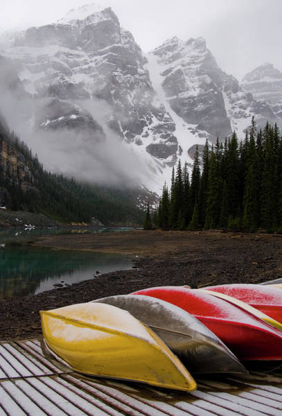 Moraine Lake Photograph - Mountain Lake And Canoes by Dorin s