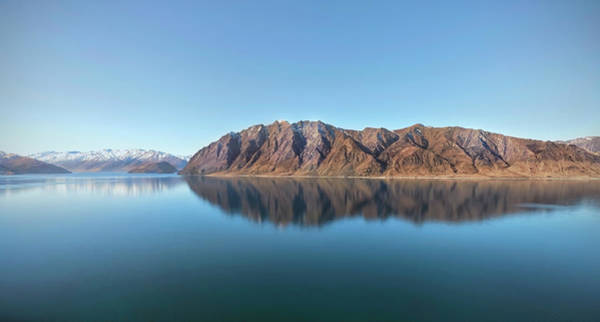 Lakes Region Photograph - Mountain Reflected On Lake Hawea by Verity E. Milligan