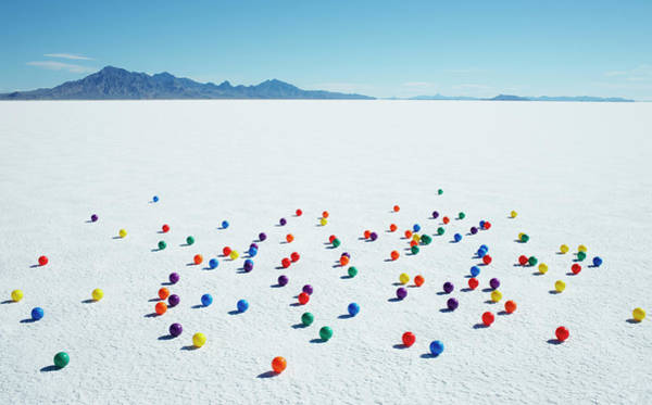 Out Of Context Photograph - Multi-colored Balls On Salt Flats by Andy Ryan