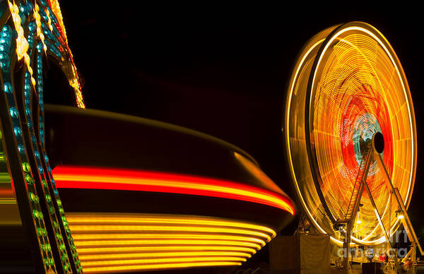 Pretty Wall Art - Photograph - Multicolor Carnival Rides In Motion by Mike Flippo