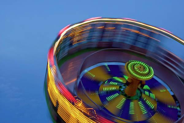 Multicolored Spinning Carnival Ride Art Print by By Ken Ilio