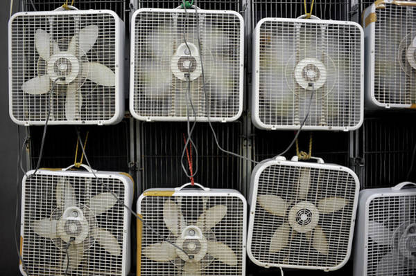 Wall Art - Photograph - Multiple Box Fans Cooling A Large Area by David Joel