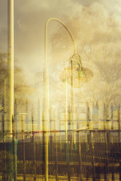 Wall Art - Photograph - Multiple Exposure Lamp And Fence by David Ridley