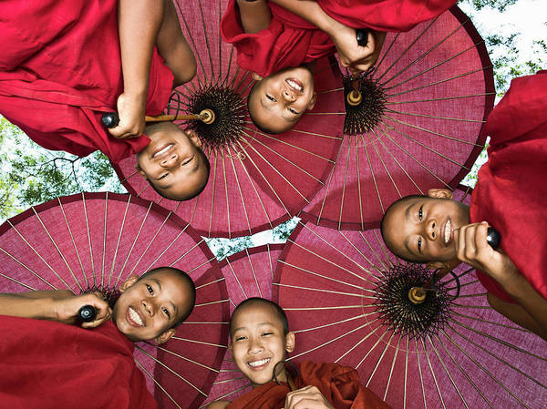 Parasol Photograph - Myanmar, Bagan, Young Buddhist Monks by Martin Puddy