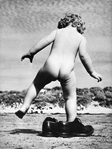 Naked Photograph - Naked Child On A Beach Trying On Shoes by Keystone-france