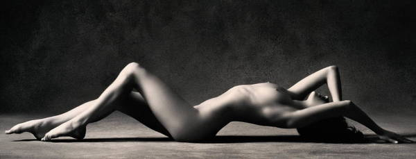 Naked Photograph - Naked Woman Lying On Floor, Knees Bent by Stuart Mcclymont