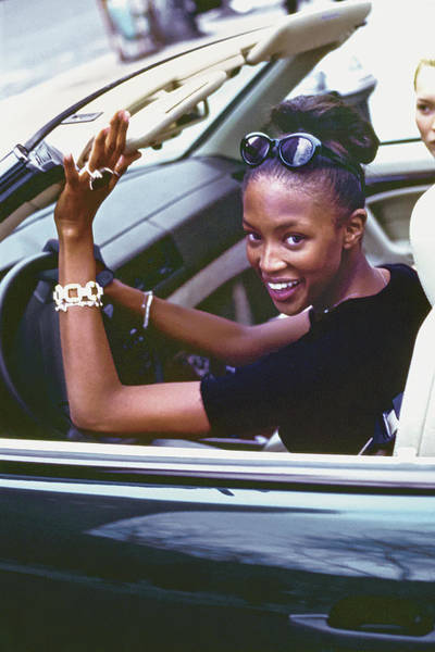 Auto Photograph - Naomi Campbell Wearing Jewellery While Driving by Arthur Elgort