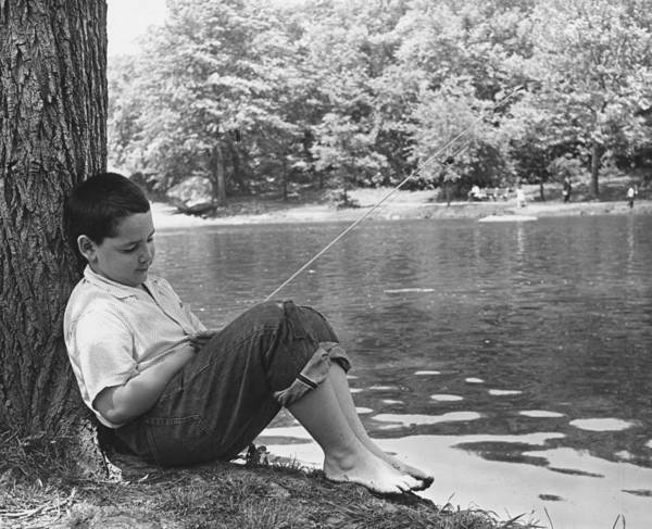 1961 Photograph - Napping Angler by Keystone