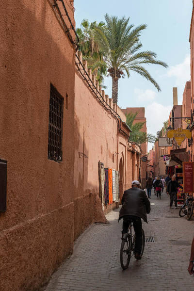 Wall Art - Photograph - Narrow Alley Local On Bike Medina Marrakech Morocco by imageBROKER - Moritz Wolf