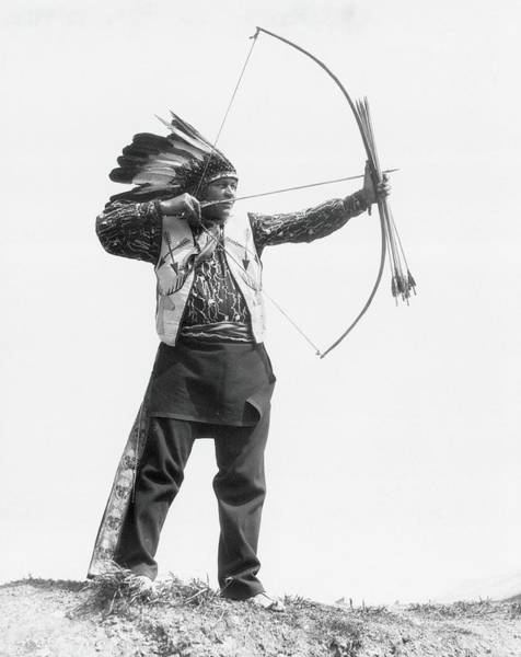 Indigenous People Photograph - Native American Man Wearing Headdress by H. Armstrong Roberts