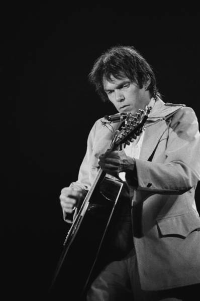 Neil Young Photograph - Neil Young Performs Live by Richard Mccaffrey