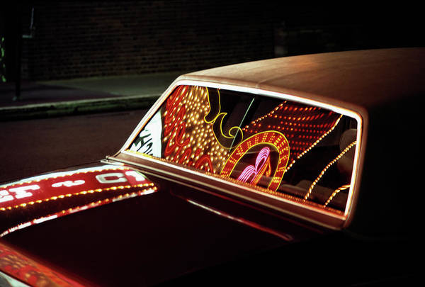 Kitsch Photograph - Neon Casino Signage Reflected In Car by Peter Miller
