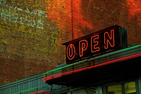 Text Photograph - Neon Open Sign On Old Diner Hotel by Matt Champlin