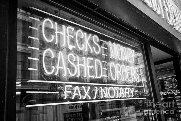 Wall Art - Photograph - neon sign in a store window for checks cashed or money orders and fax notary Chicago IL USA by Joe Fox