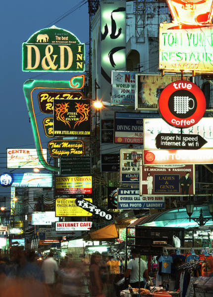 Thai Photograph - Neon Signs Lining Busy Street At Night by Gary Yeowell