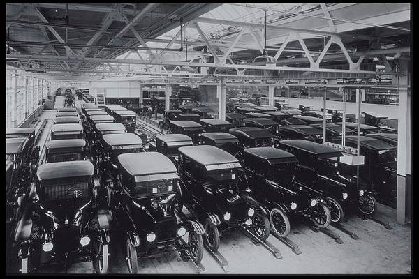 Manufacturing Plant Wall Art - Photograph - New Ford Motorcars Grouped In Warehouse by Archive Holdings Inc.