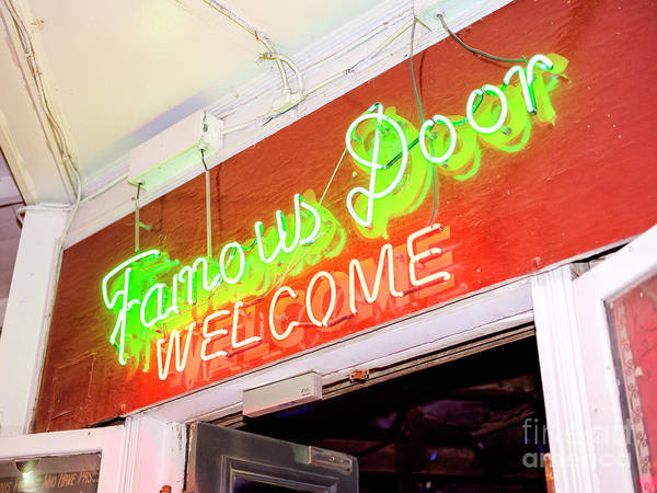 Photograph - New Orleans Famous Door Welcome On Bourbon Street At Night by John Rizzuto