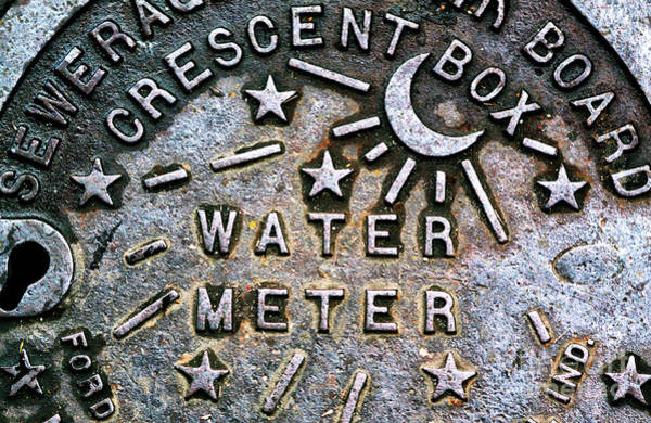 Nola Photograph - New Orleans Water Meter Cover by John Rizzuto