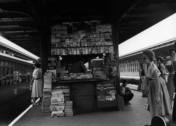 Publication Photograph - News Stand Between Train Station by George Marks