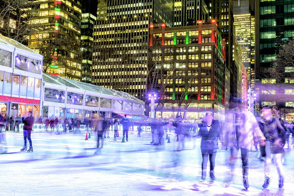 Photograph - Night Skating At Bryant Park In New York City by John Rizzuto