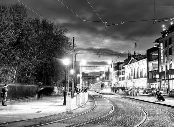 Wall Art - Photograph - Night Tram In Dublin by John Rizzuto