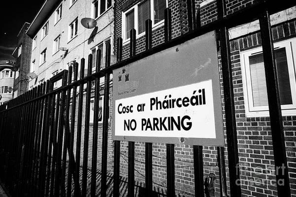 Wall Art - Photograph - no parking sign on railings outside Ballybough house Poplar row flats dublin city council flats Dubl by Joe Fox