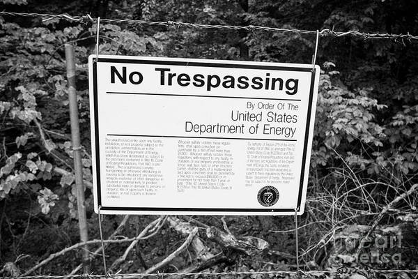 Wall Art - Photograph - no trespassing sign on the boundary fence of the Y-12 complex in the former secret city of Oak Ridge by Joe Fox
