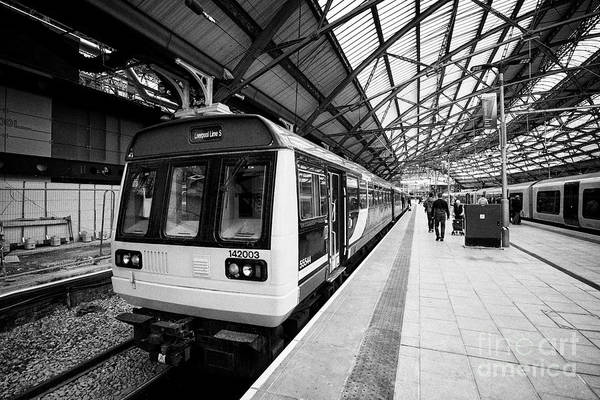 Wall Art - Photograph - northern rail class 142 142003 train Lime Street station Liverpool Merseyside England UK by Joe Fox