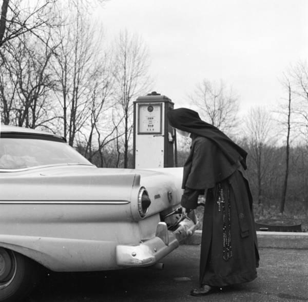 Protective Clothing Photograph - Nun Driver by Sherman