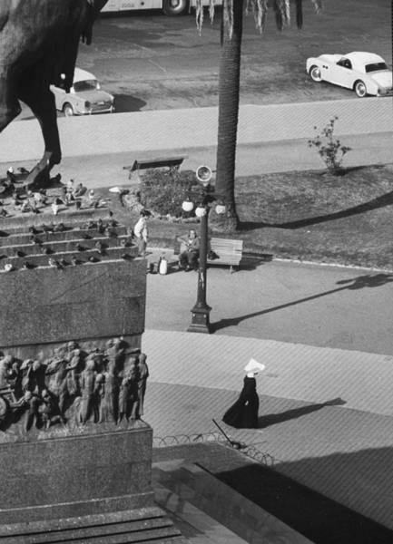 Montevideo Wall Art - Photograph - Nun Making Her Way Across Park Square by Leonard Mccombe