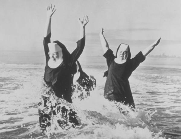 People Photograph - Nuns In The Surf by American Stock