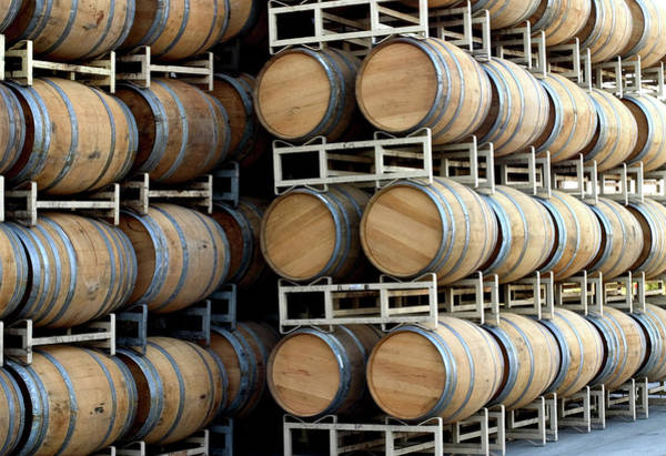 Compartments Photograph - Oak Barrels Stock In Cellar Outdoors by Swalls