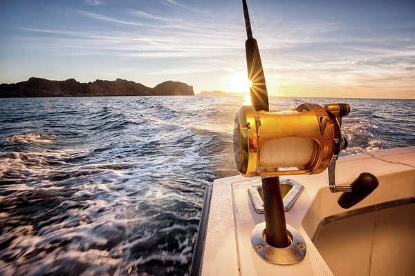 Sport Fishing Photograph - Ocean Fishing Reel On A Boat In The by Grandriver