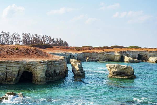 Stone Wall Art - Photograph - Of Rocks And Sea Caves In Oegeia, Cyprus by Iordanis Pallikaras