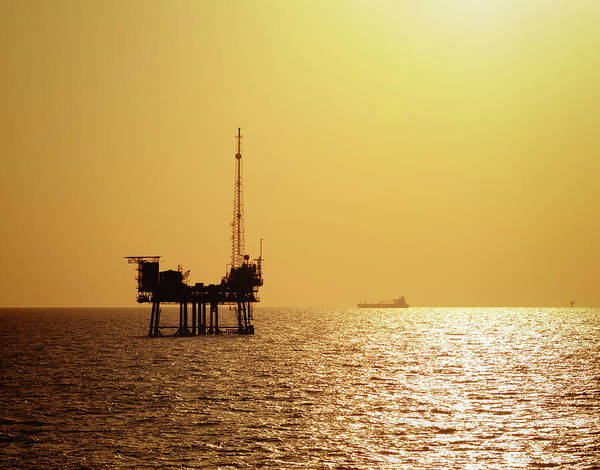 Offshore Wall Art - Photograph - Off Shore Oil Rig At Sunset by Dragansaponjic