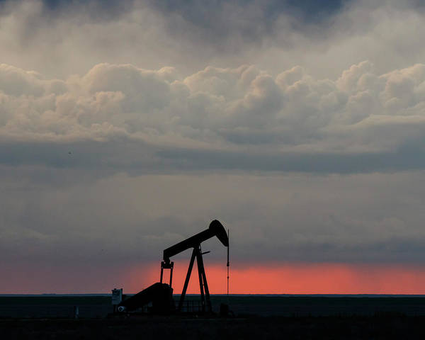 Photograph - Oil Pump And Stormy Sunset 01 by Rob Graham