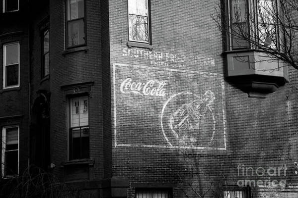 Photograph - Old Advertising Poster Of Soda Drink On The Brick Walls Of A Building. by Joaquin Corbalan