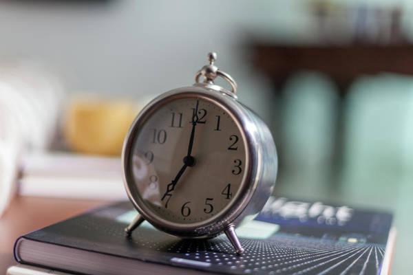 Alarm Clock Photograph - Old Alarm Clock by Julio Lopez Saguar