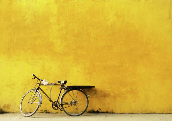 Hoi An Photograph - Old Bicycle Parked Against Worn Yellow by Cati Kaoe