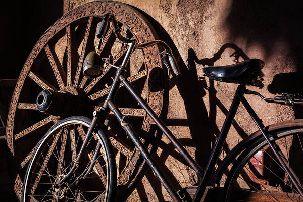 Photograph - Old Bike And Wagon Wheel by Jeanette Fellows
